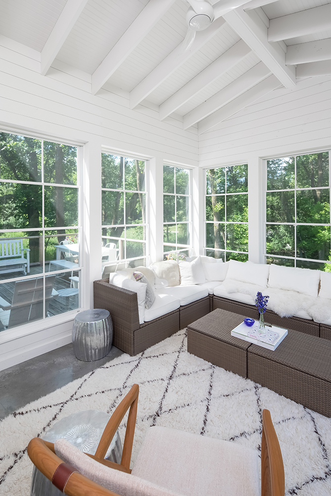 Three-season porch for this Mendota Heights home built by AMEK enhances the connection to nature.