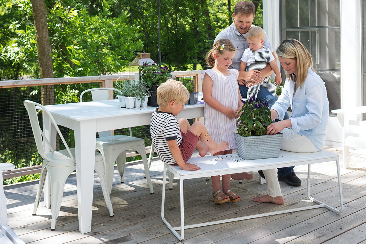 This AMEK home was designed for an active family. Here, the family enjoys some bonding time on the deck.